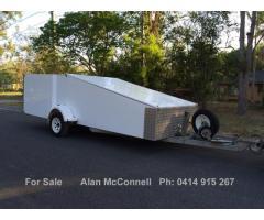 Tilt enclosed race car trailer
