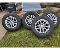 "Set of 4.Goodyear Fortitude HT 265/65R18 tires with 18"" chevy rims"
